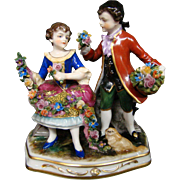 Dresden porcelain figurine man woman flowers pekingese dog Muller & Co