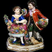 Dresden porcelain figurine man woman flowers pekingese dog Muller & Co