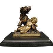 Antique French bronze sculpture of dog and sleeping child