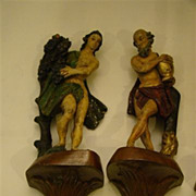 Hand carved pair of  hanging wall figurines