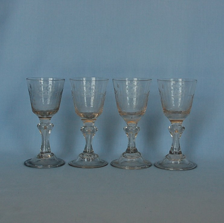 Set of Four 18th Century German Blown Clear Glass Crested Wine Glasses