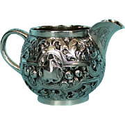 19th Century English Sterling Silver Embossed Creamer by Isidor Weil