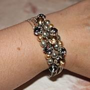 Pretty in Peach Plastic Pearl and Rhinestone Memory-wire Cuff Bracelet