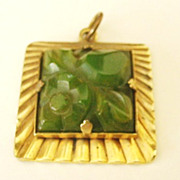 Carved and Pierced Green Bakelite Pendant