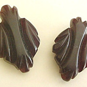 Pair of Carved Brown Bakelite Dress Clips