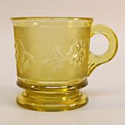 """Dahlia"" Pattern Amber Pressed Glass Mug"