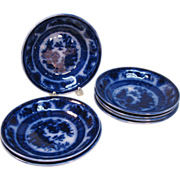 Seven Flow Blue Bowls/Saucers Temple Pattern