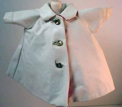 Original Madame Alexander Cissette White Faux Leather Raincoat, 1958.
