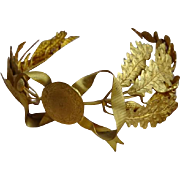 Delicious gleaming gilt metal laurel and oak leaf wreath award crown ribbon bow medallion dated 1925