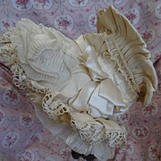 Extravagant frothy antique French doll's or child's cream wired bonnet ribbon bows, lace, silk millinery bloom