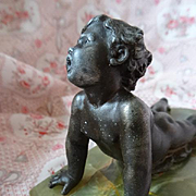 Adorable white metal cherub mounted onyx base , circa 1900