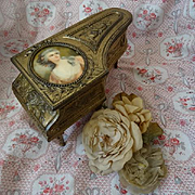 Exquisite antique French musical gilt metal piano jewelry box with miniature 18th century beauty