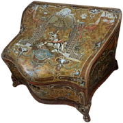 Unusual Faded grandeur antique French curvy dresser stationary box with toleware panels frolicking cherubs swags
