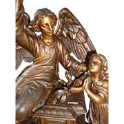 Heavenly 19th C. patinated spelter winged angel and young child statue group