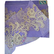 Delicious French unused ecru lace embellishments ( 11 )  shop packaging :  mauve tulle :  71 inches long