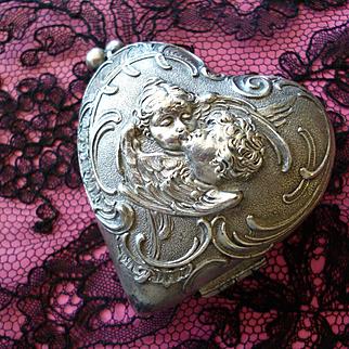 Adorable white metal heart box : reliquary : lovers : kissing winged cherubs : circa 1900