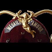 Vintage French shop display presentation piece : Cherub Cupid  motifs : religious medals