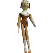Early 4 1/4 inch wooden penny peg doll : elaborate hair style : painted face
