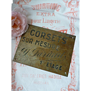 Decorative old brass lingerie shop plaque : Corsets sur Mesure