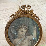 Decorative French brass picture frame : ribbon bow pediment : cherub engraving : circa 1900