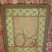 Decorative antique French easel green brocade photo frame : gold metallic passementerie trim : circa 1900