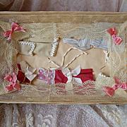 """Darling antique French """"Au Bon Marche"""" Etrennes cardboard presentation trunk : doll clothes : bedding"""