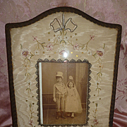 Faded grandeur French ribbon work boudoir photo frame : metallic trim : sequins : ribbon bow , circa 1900 ( no. 2 )