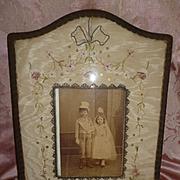 Faded grandeur French ribbon work boudoir photo frame : metallic trim : sequins : ribbon bow , circa 1900 ( no. 2 )