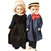 Adorable pair antique boy and girl wooden dolls : original clothing : glass eyes