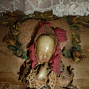 Rare 18th C. French ex voto wax baby : child : doll presented on a cushion : metallic lace : ribbons