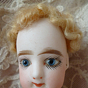 Darling little French child like fashion doll : FG : blue glass eyes : 12 inches : circa 1880