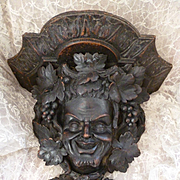 Faded grandeur antique hand carved black forest wall bracket shelf : Bacchus : grape and vine leaf motifs