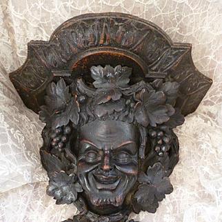 Faded grandeur antique hand carved black forest wall bracket shelf : Bacchus : grape and vine leaf motifs