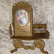 Rare antique miniature bronze vanity stand : porcelain plaque : young girl cherub cupid : fashion doll