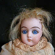 Adorable antique  mignonette doll : blue glass eyes : Au Nain Jaune magasin label