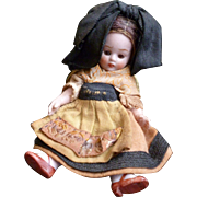 Darling all bisque mignonette doll : original clothing
