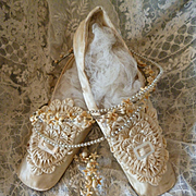 Delicious pair faded grandeur 19th C. French cream silk satin ladies wedding shoes : rosettes : MOP buckle : period display