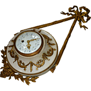 Decorative French ormolu and marble Louis XVI style chiming wall clock : large bow pediment