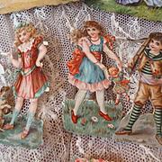 Batch of  14 decorative old die-cut paper children : doll : dog : cat motifs : projects