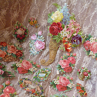 Selection of 24 old Die-Cut paper floral motifs : Lily of the valley : roses : pansy : projects