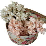 Delicious old French fabric box filled with pink and white millinery flower posies