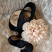 Quality 19th C. French black satin ribbon with picot edging : still on packaging roll