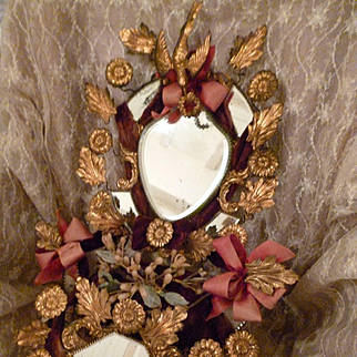 Faded grandeur French bride's boudoir wedding stand : ribbon bows : wax pieces