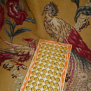 72 old French unused yellow silk buttons on card : 1/2 inch diameter