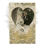 Novelty Antique French Wedding Card Bride and Groom photo surrounded by feathers, glitter and ribbon