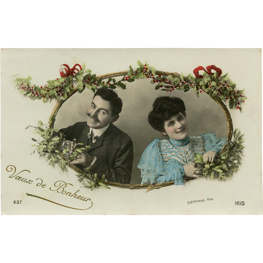 1908 French Christmas Postcard of Edwardian Couple inside Holly Wreath