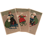 3 Antique Embossed European Postcards of Children in Winter Sled Scenes