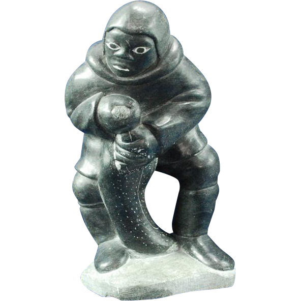 Large Inuit Eskimo soapstone sculpture of hunter with seal signed