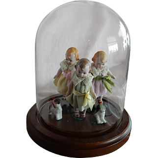 OUTSTANDING Grouping of Three Antique All Bisque Mibs Dolls with Bisque Puppies