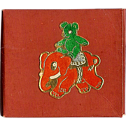 Christmas decoration gummed seals depicting a Teddy bear riding a toy Elephant - Dennison Company mid Century